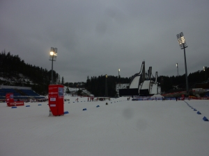 The cross country stadium with the ski jumps in the background