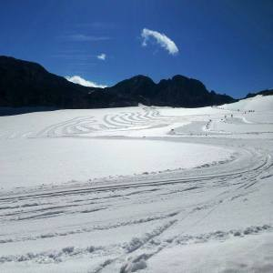 The cross country ski tracks on the Dachstein glacier on a sunny morning
